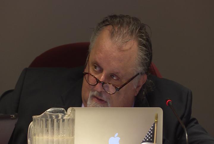 4th Ward Alderman Mike Farha prepares to talk during city council.