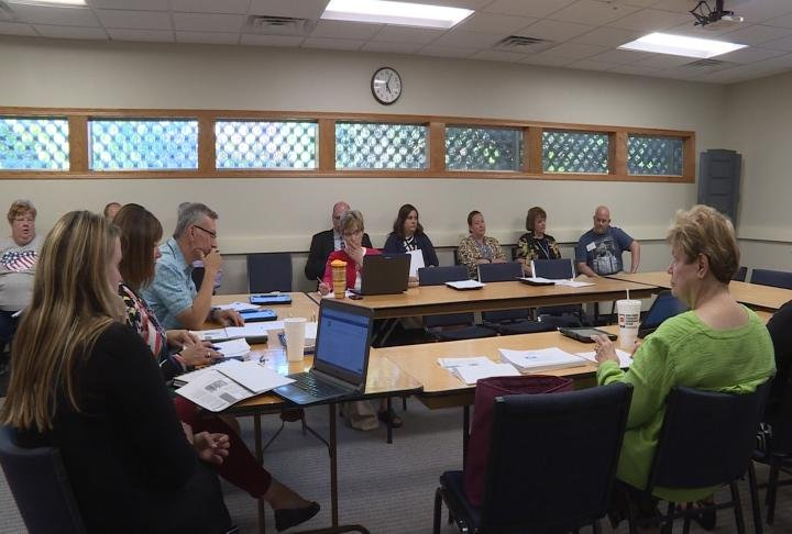 Quincy Curriculum committee prepare for their meeting.