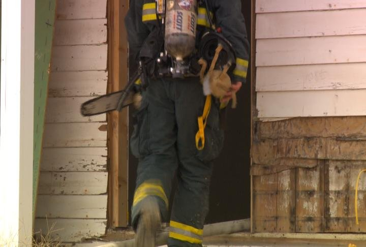 Firefighter walks into the home off Ellington Road.