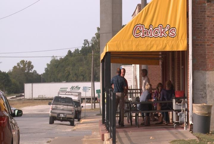 Residents eat outside at Chicks on the River.