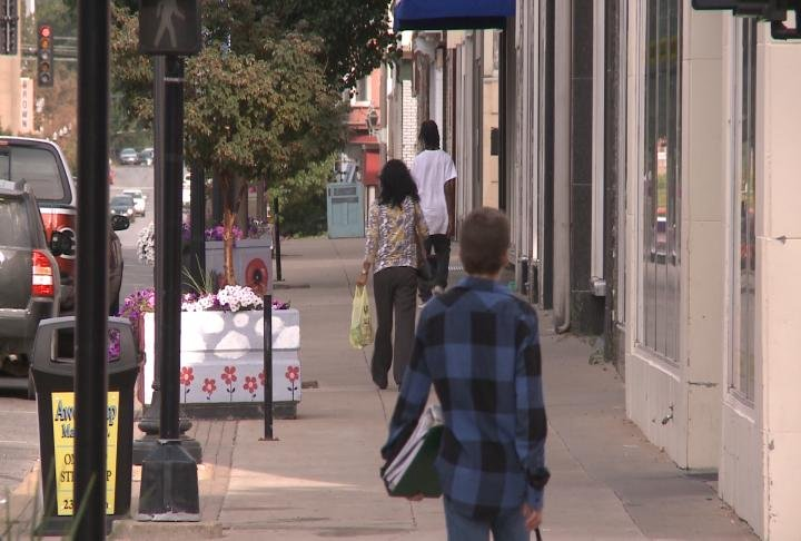 Residents walk in downtown Quincy.