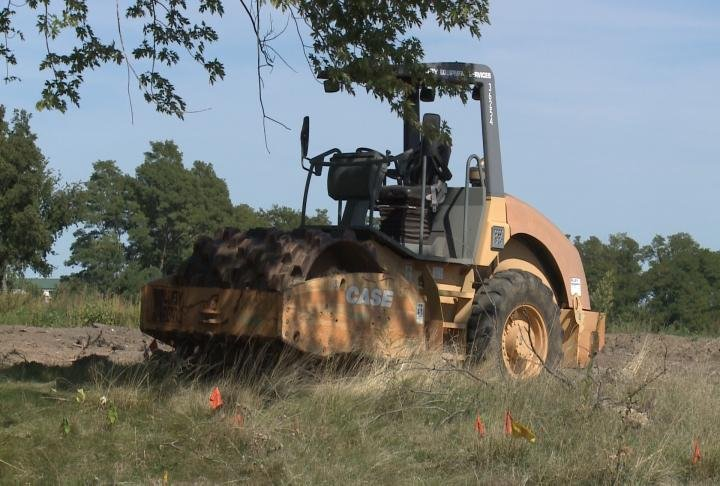 Construction equipment sit idle at proposed project spot.