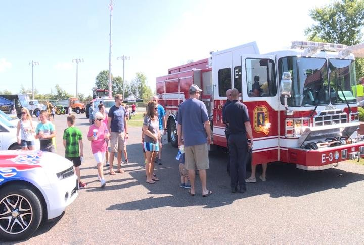 Families taking in the firetruck at the Fall Festival