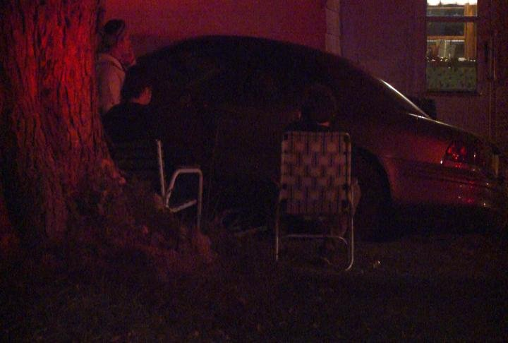A car up against an Adams County home after a crash Thursday night.