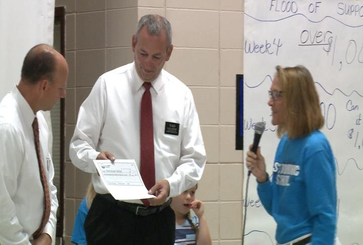Hy-Vee was at the school on Friday to accept check for the Hurricane Relief.