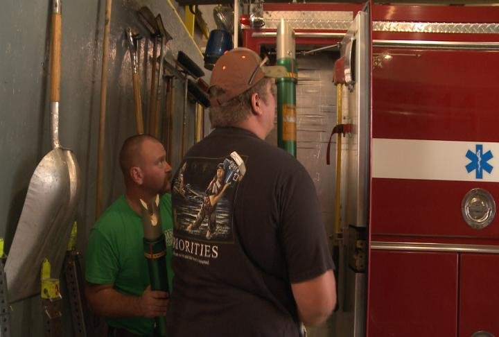 Canton Firefighters remove equipment from one of their trucks.