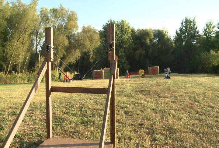 A large sling shot aimed at targets.