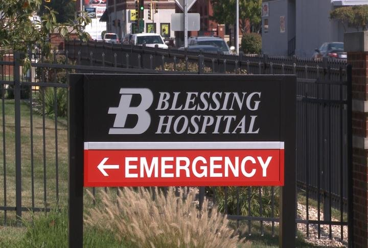 Sign directs traffic towards the Blessing Hospital Emergency Department.