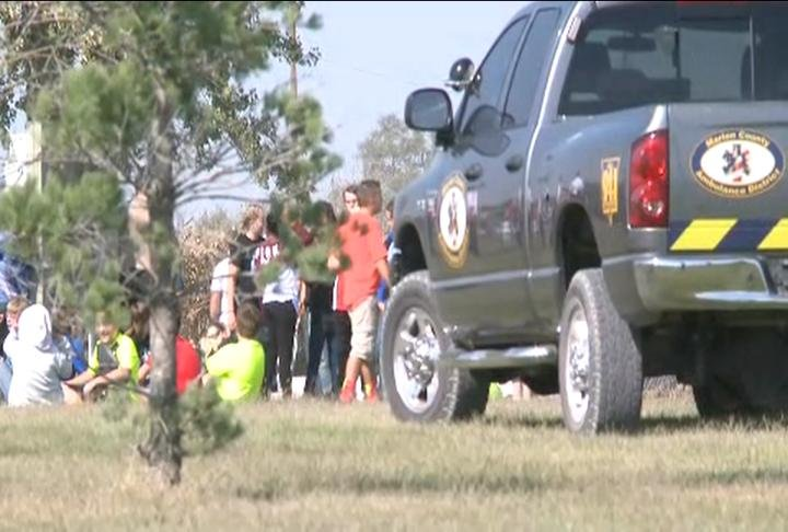 Students gathered at the ball field while authorities investigated.