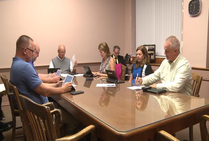 Aldermen prepare for Quincy's Finance Committee meeting.