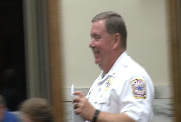 Deputy Chief Mike Benjamin walks up to talk during the meeting.