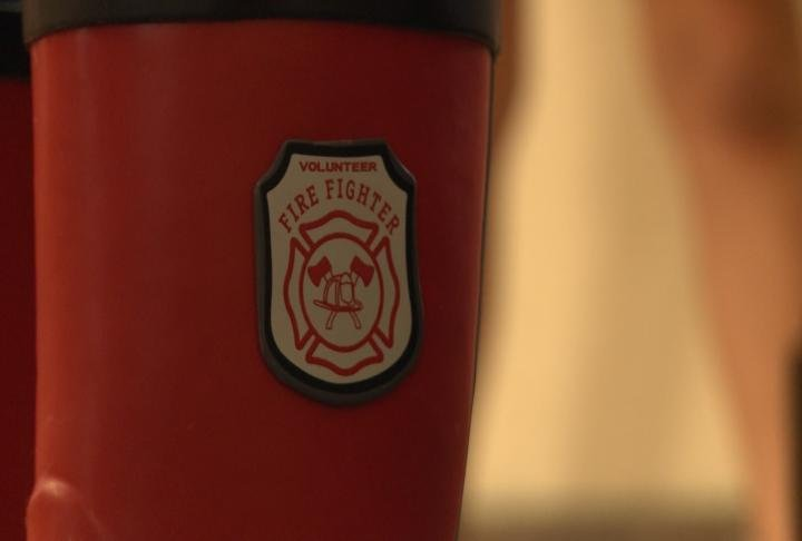 A volunteer firefighter logo on the side of a student's boot.