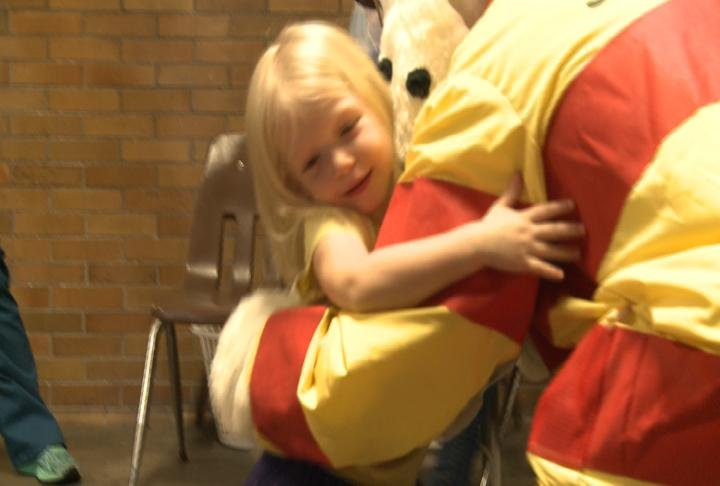 Student gives a hug to Sparky the fire dog after a tour of Central Station.