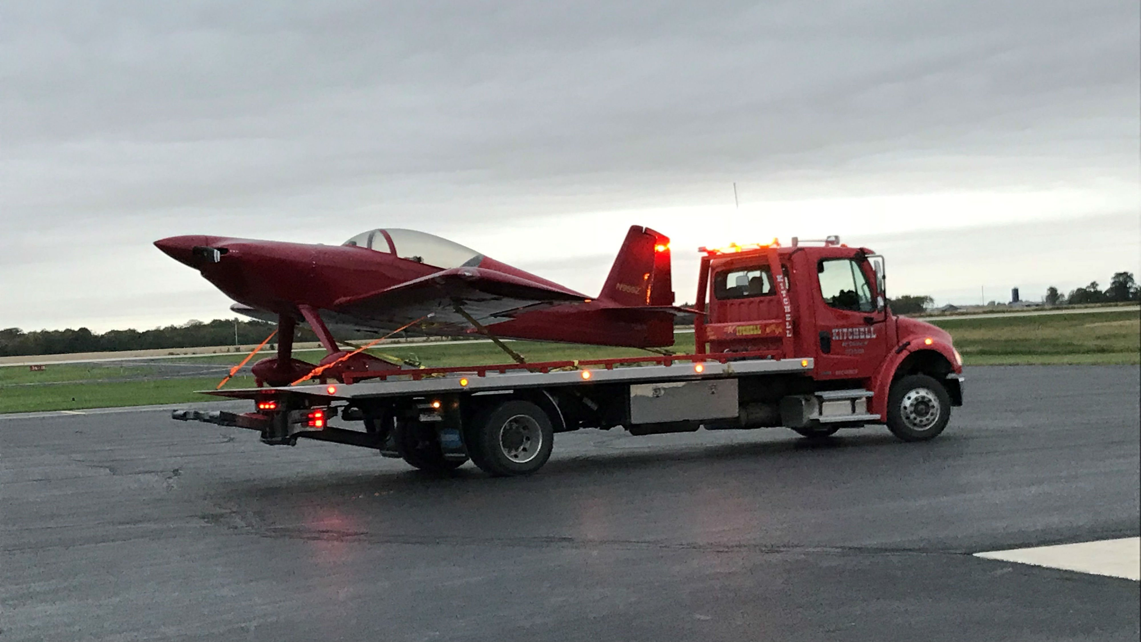 Officials put the plane on the back of the tow truck to take it back to the airport.