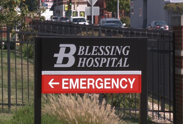 Sign marks the Emergency Room entrance for Blessing Hospital.