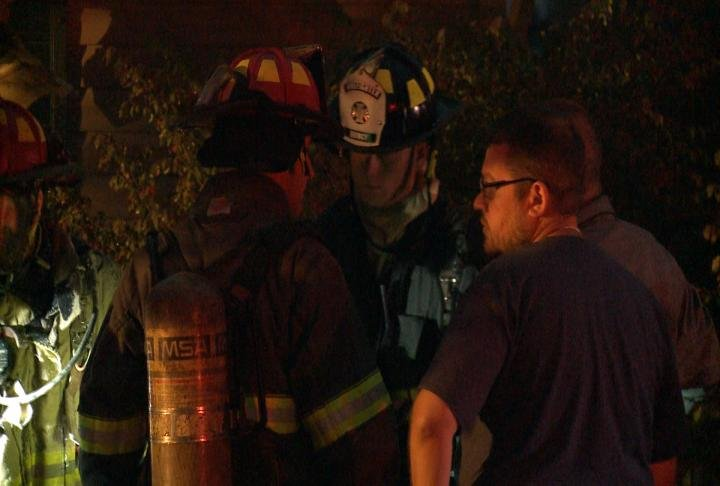 Firefighters talk to those on scene.