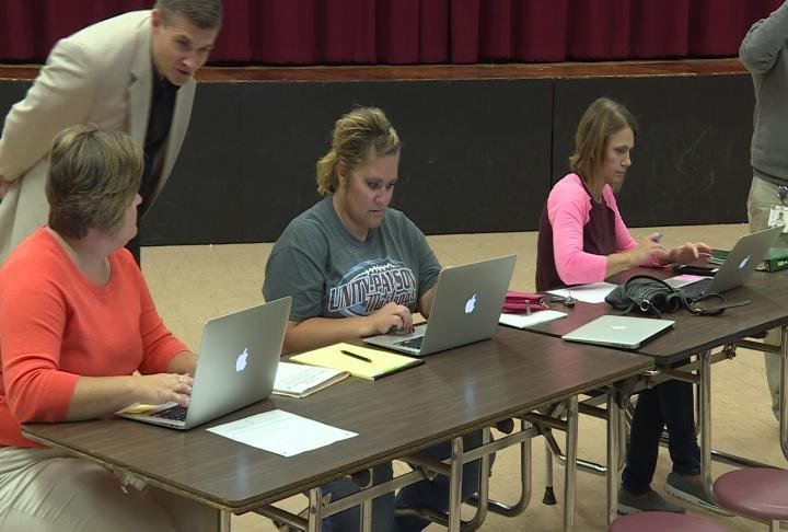 Parents file FAFSA on their computers.