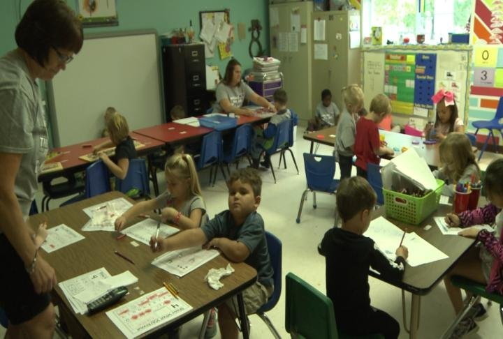 Anderson's classroom has lots of students, but not a lot of space.