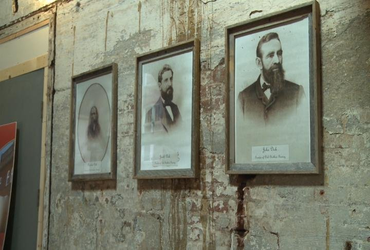 Pictures of the three Dick brothers who founded Dick Brothers Brewery hangs on a wall.
