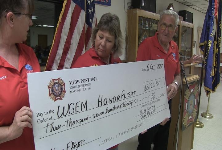 Check presented for more than $3,000 from golf event in July.