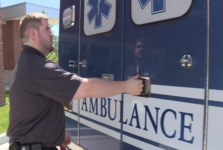 A worker closing the doors on one of the MDH ambulances. MDH will soon hand over ambulance duties to another company.
