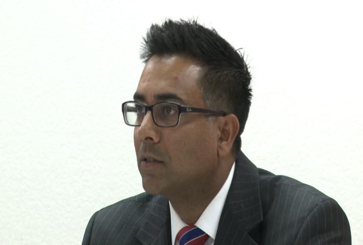 Quincy School Board President Sayeed Ali listens to speaker.