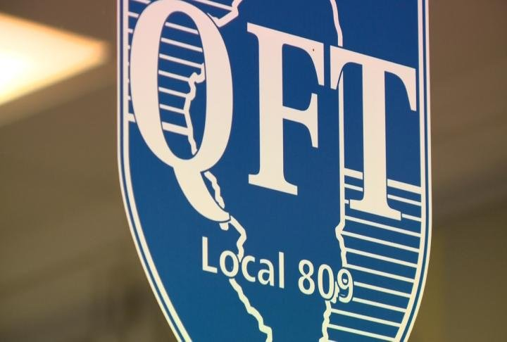 Quincy Federation logo displayed in a window.