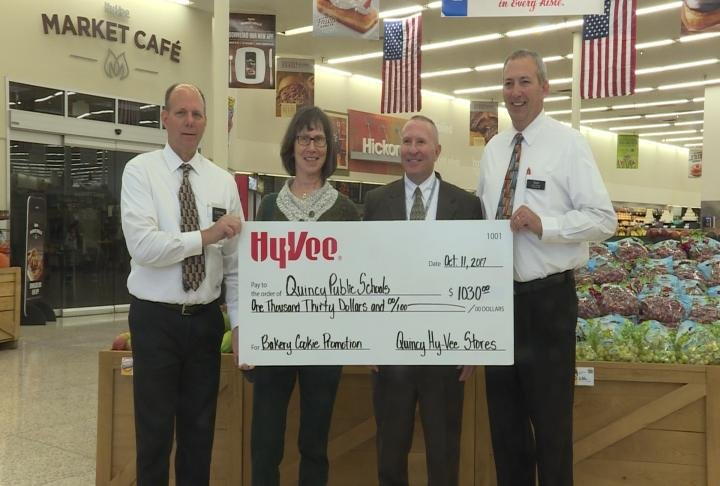 Hy-Vee presented a check to QPS on Wednesday.