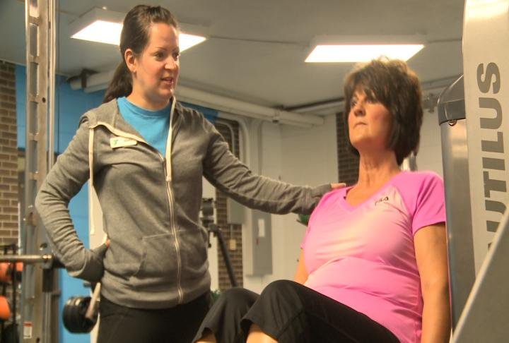 Blickhan working with a personal trainer during the program