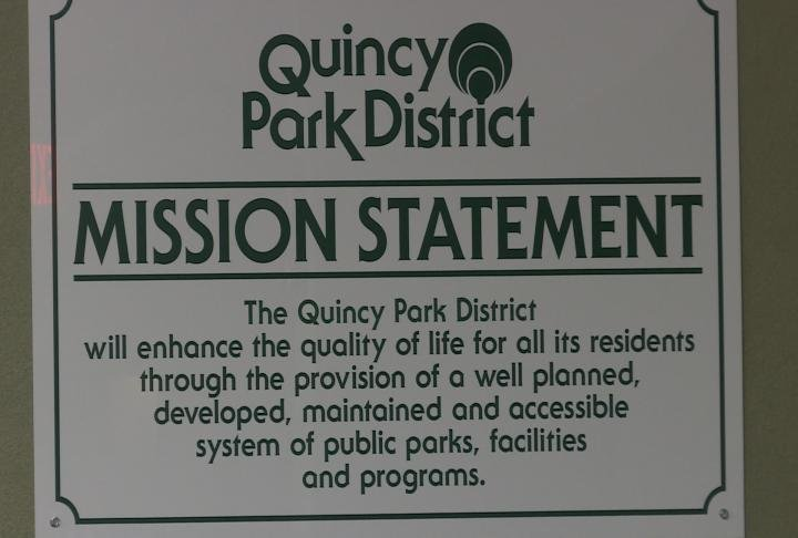 Quincy Park Board Mission Statement displayed in the board room.