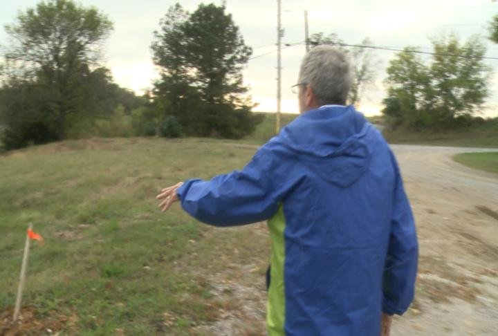 Pastor Jack Emmite points to where the new church will be built.
