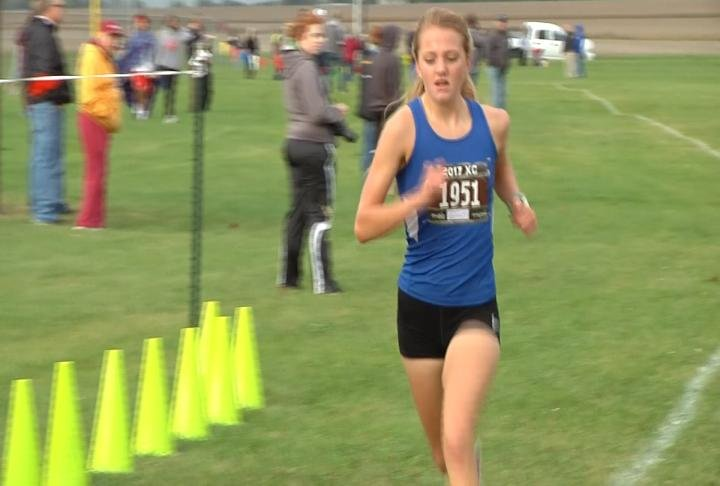 Quincy's Lydia Kurfman ran a time of 18:16 to claim the WB6 title.