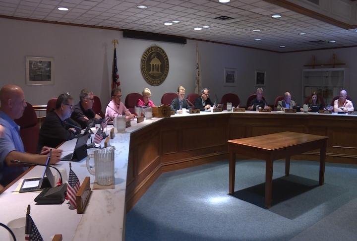 Quincy City Council prepare for its Monday meeting.