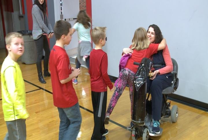 Archambo receives hugs from Western Elementary students