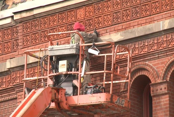 Crews tuckpointing the courthouse bricks.