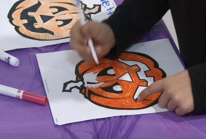 Students colored Halloween pictures at the event.