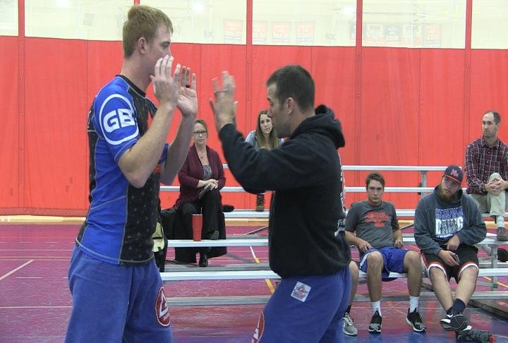 Instructor Beau Viehmann shows how to protect head in an altercation.