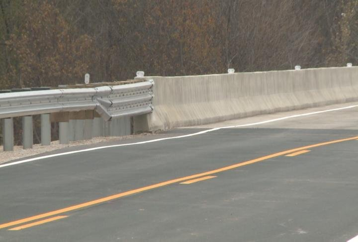 Re-surfaced road on newly constructed bridge.