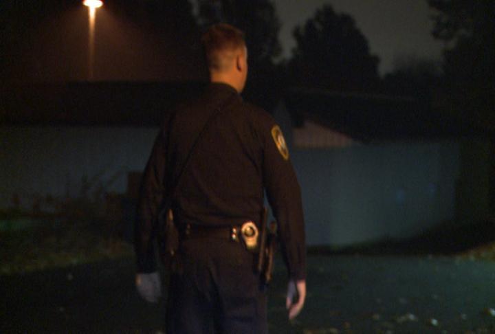 Officer walks around.