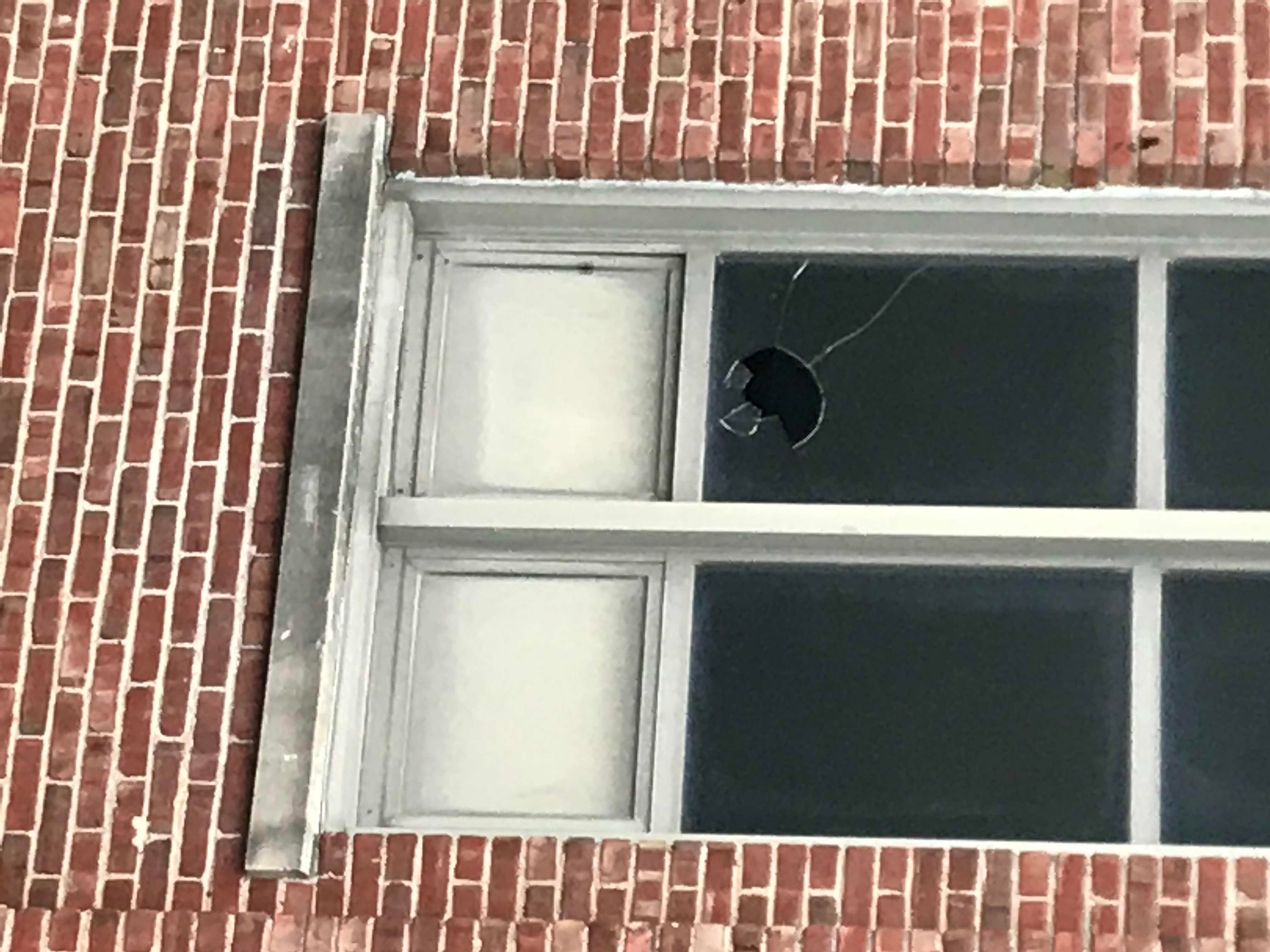 Broken window at the old Stowell Elementary.
