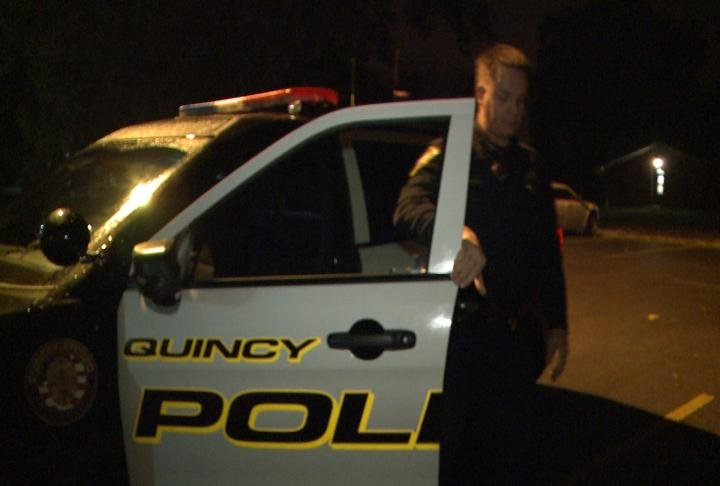Quincy Police Officers gets out of his car.