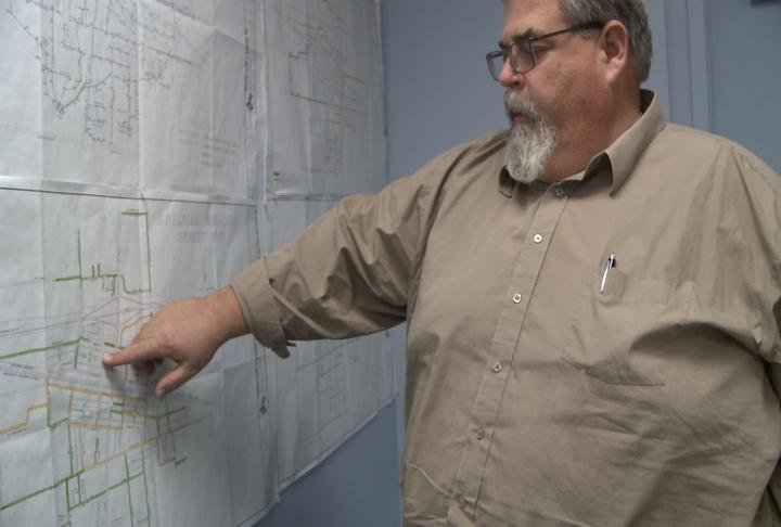 Shelbina City Clerk Tim Lacy shows where street repairs are needed.