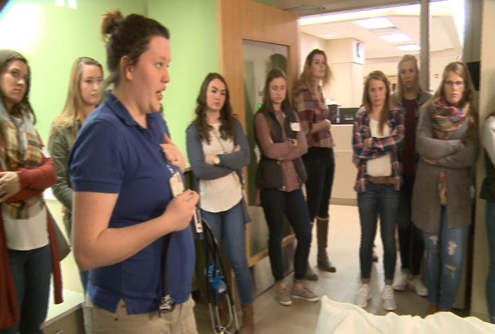 Nursing students showing how the simulator works