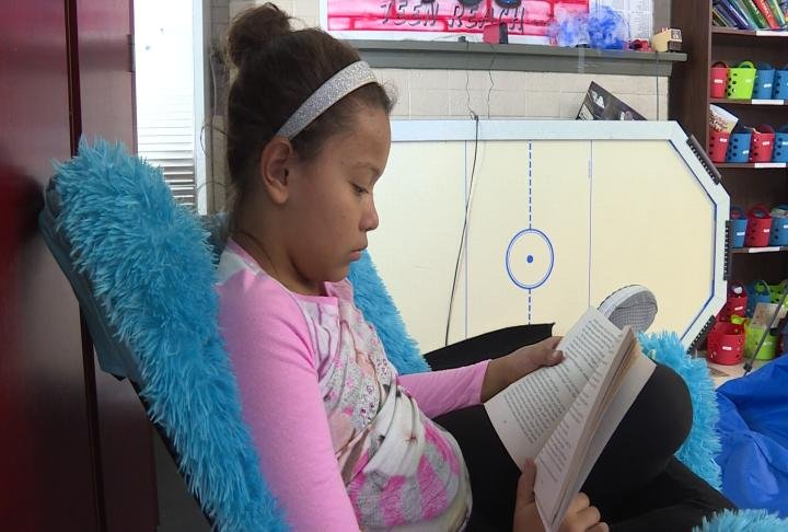 Student reads a book.