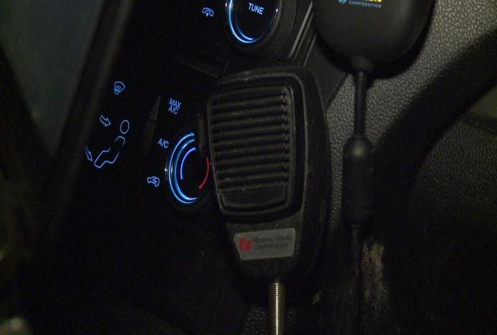 Radio microphone hangs in a police car.