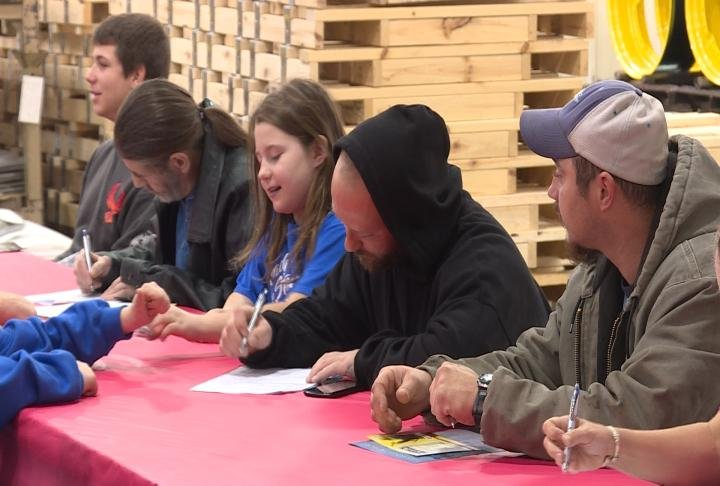 Job seekers filling out an application