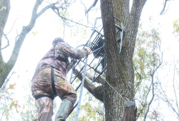 Hunter Kyle Sethaler climbing into a deer stand