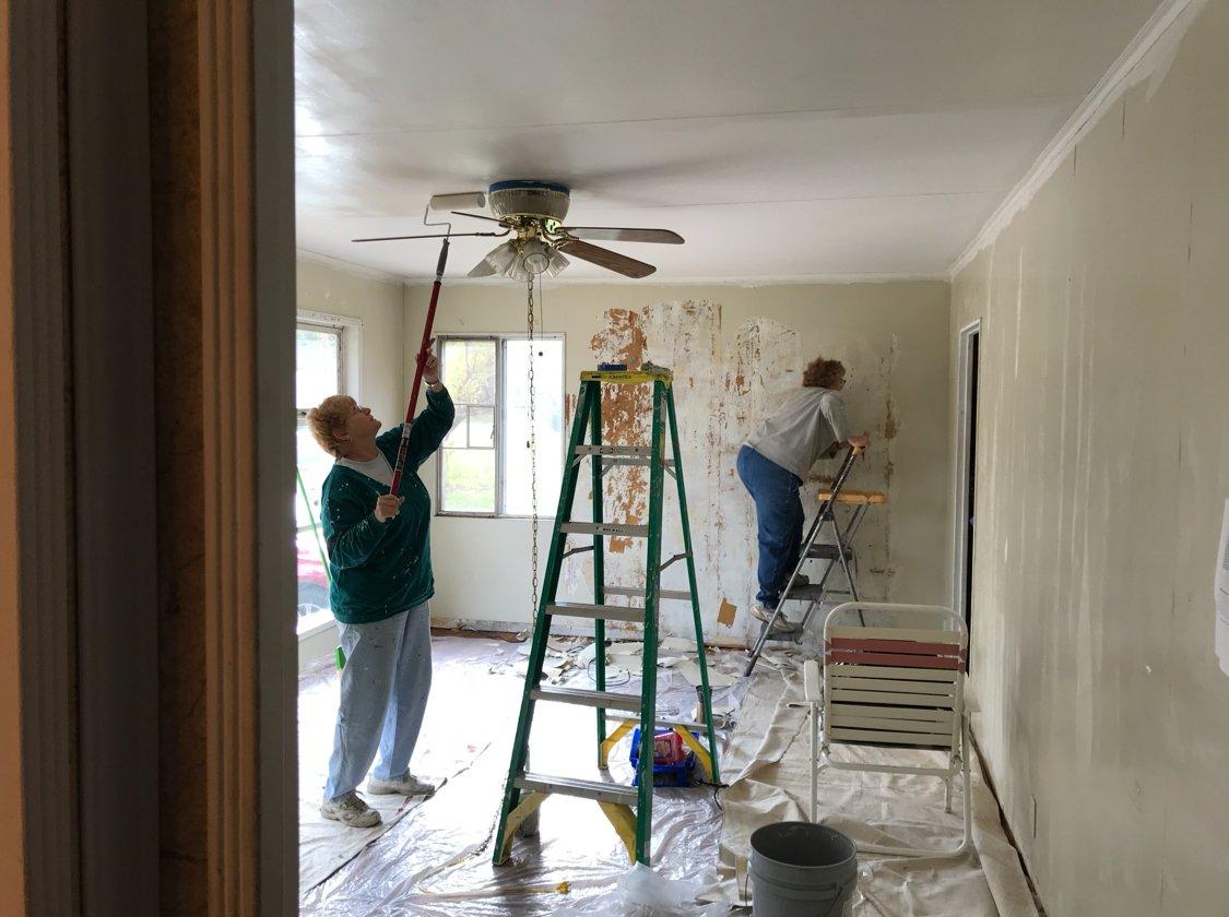 Volunteers working on the living room