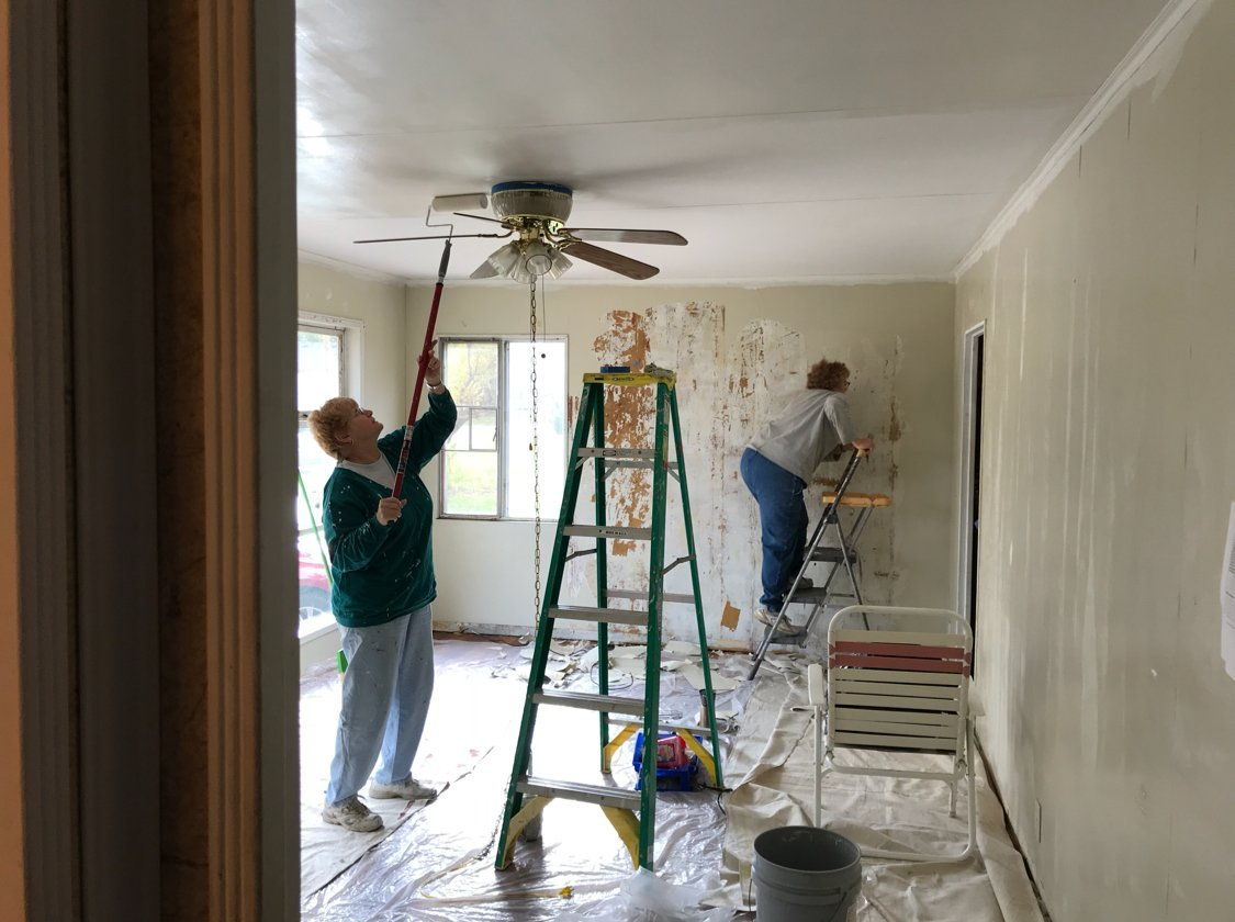 Volunteers working on the living room