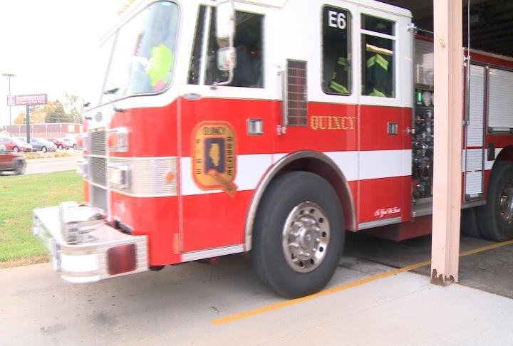 Firefighter pulls out the fire truck from station six.